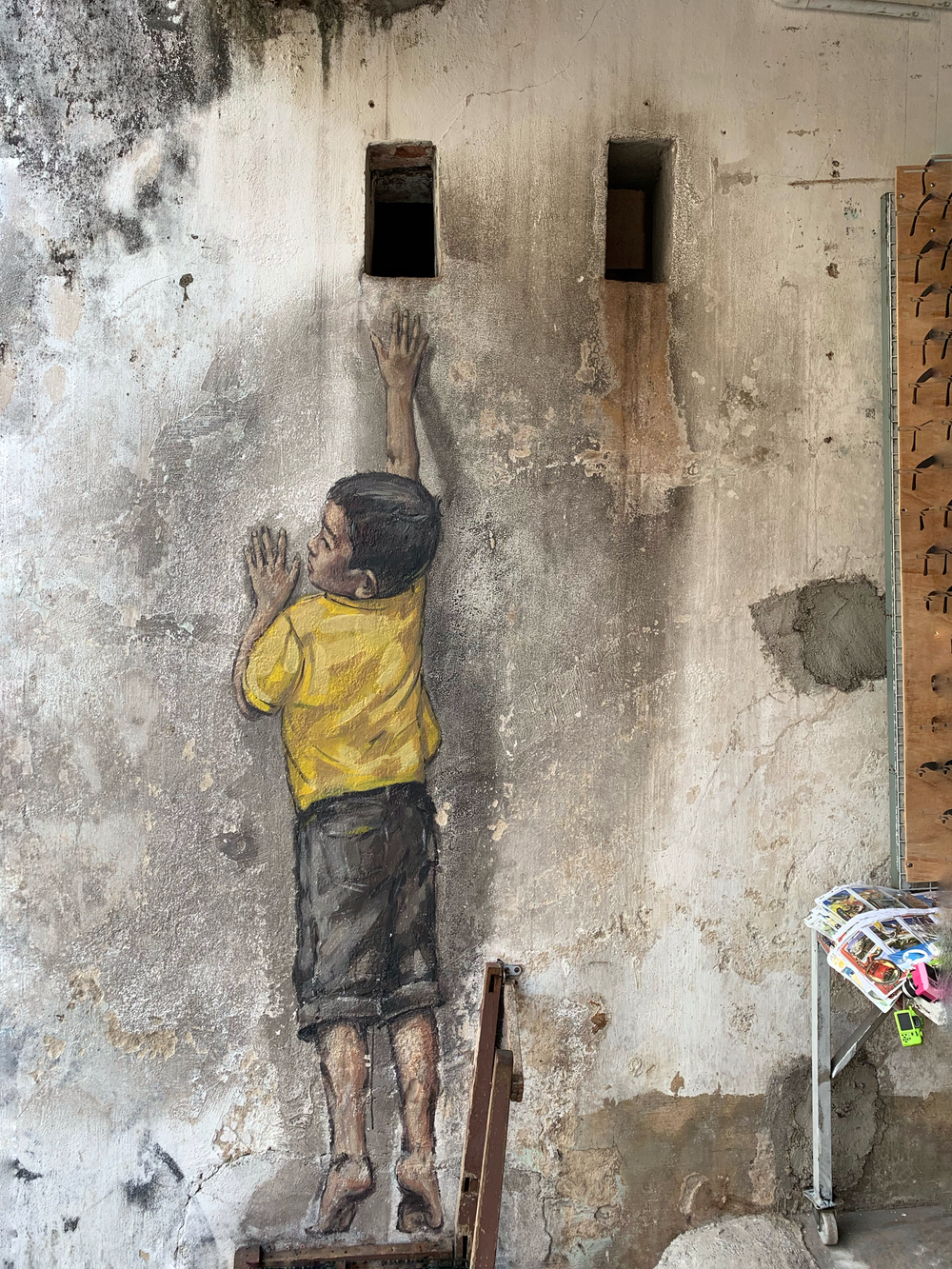 boy in yellow shirt painting