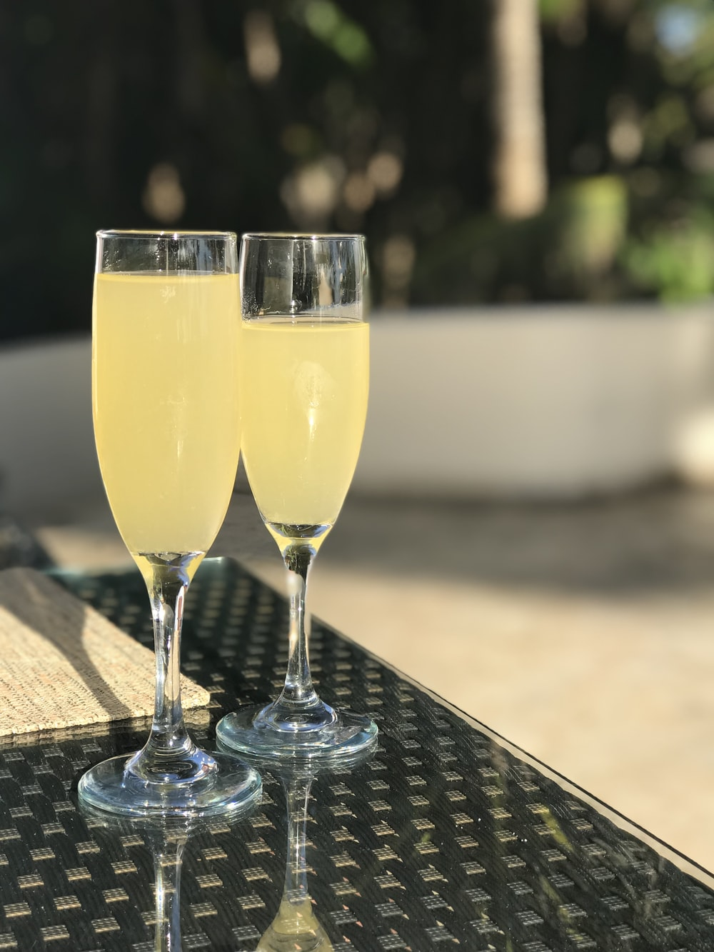 selective focus photography of two champagne flute glasses