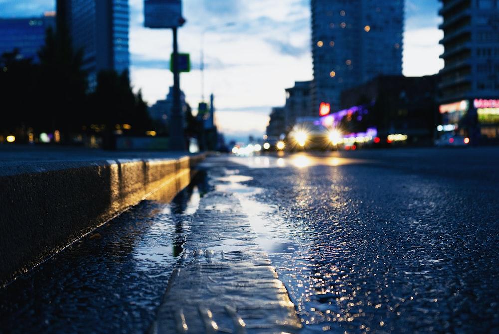 closeup photo of road between buildings