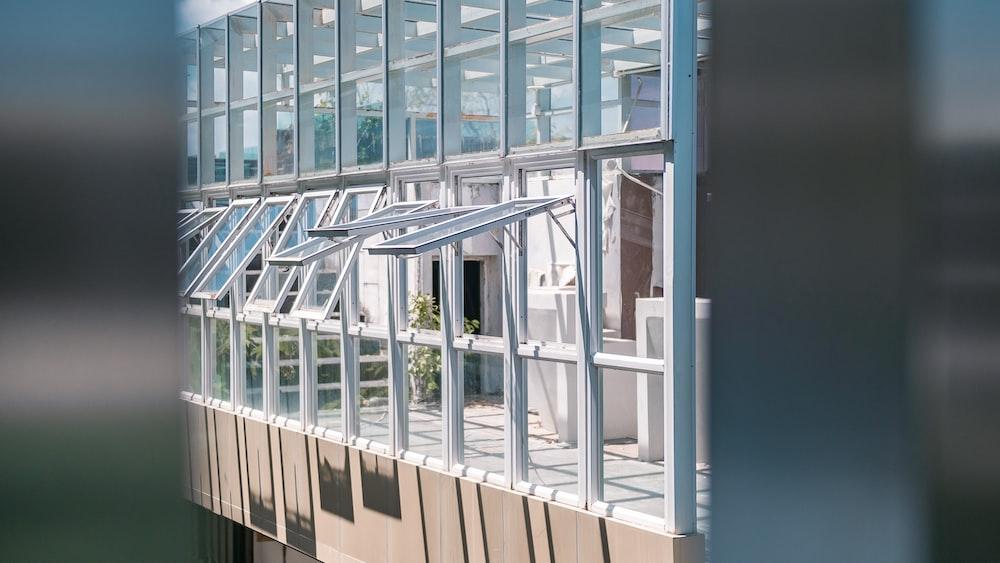 opened white metal framed glass windows