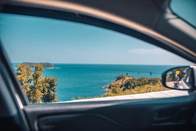 coastal view through vehicle window phuket zoom background