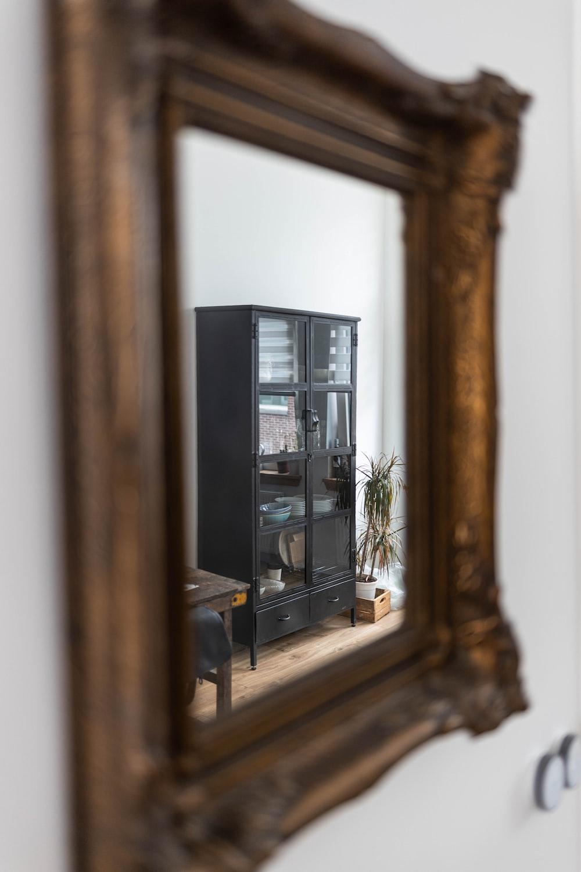 brown-framed mirror