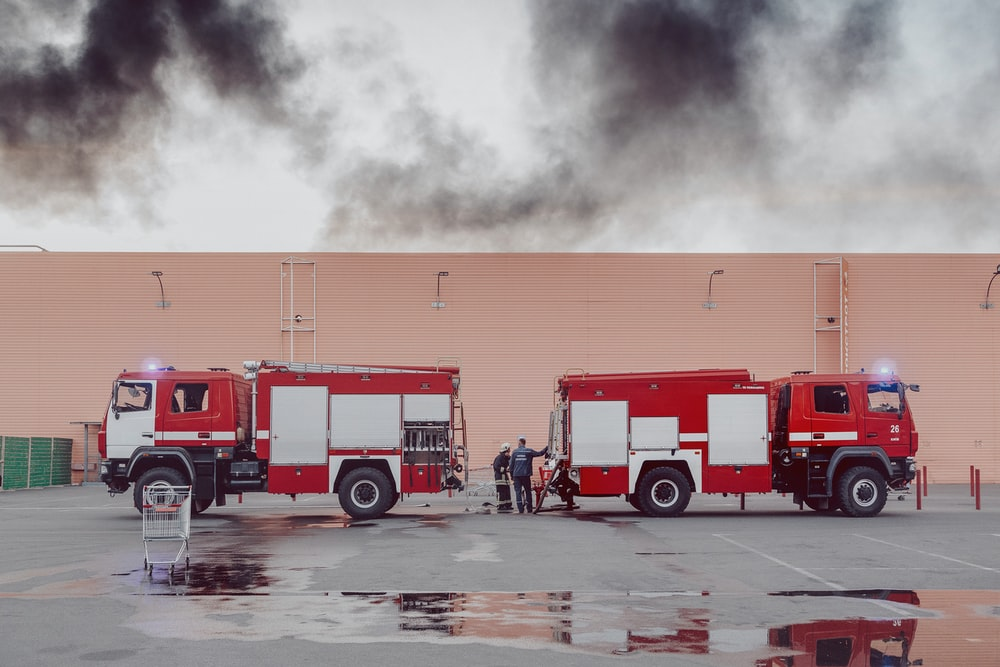 two red and white fire-ruck during daytime