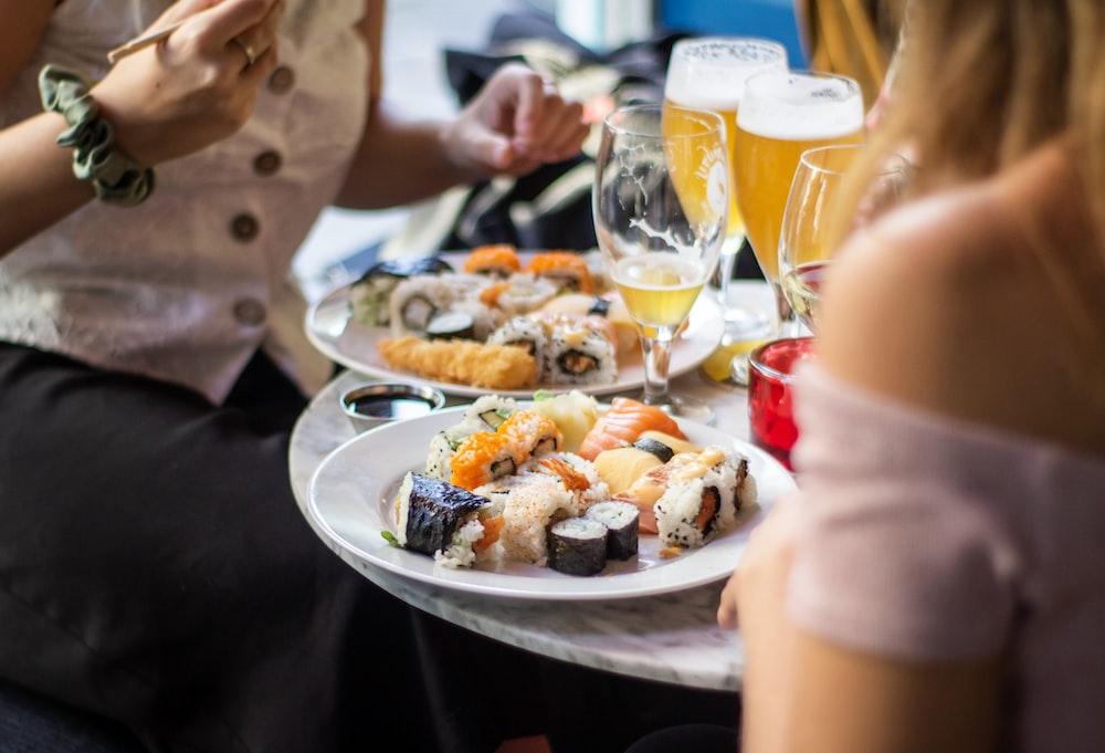people near foods on table