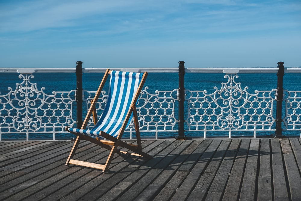 blue and white outdoor lounge chair on balcony during daytime
