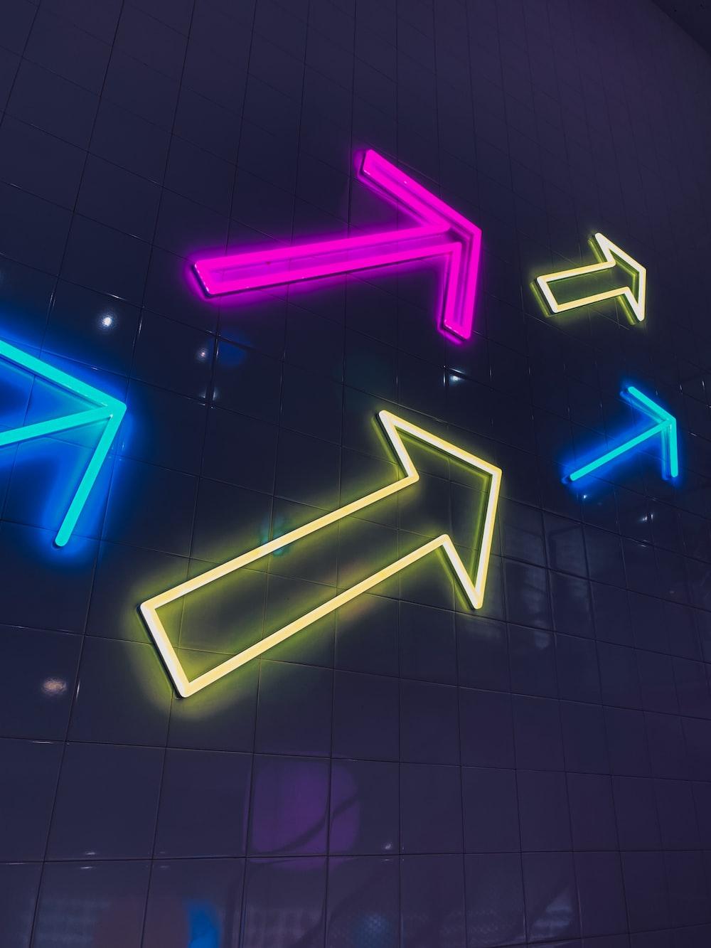 arrow neon signages