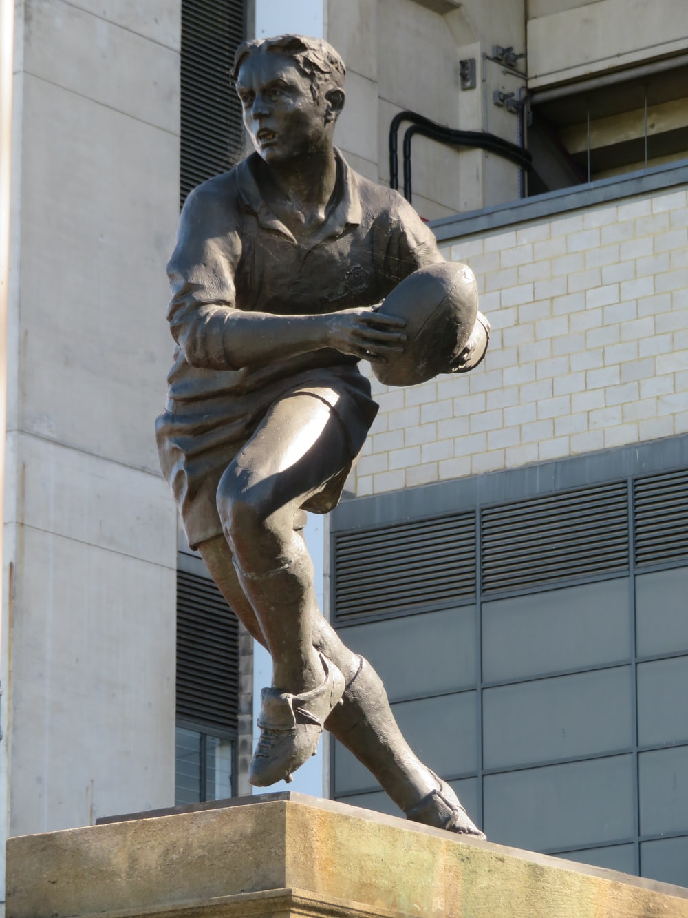 male rugby player statue