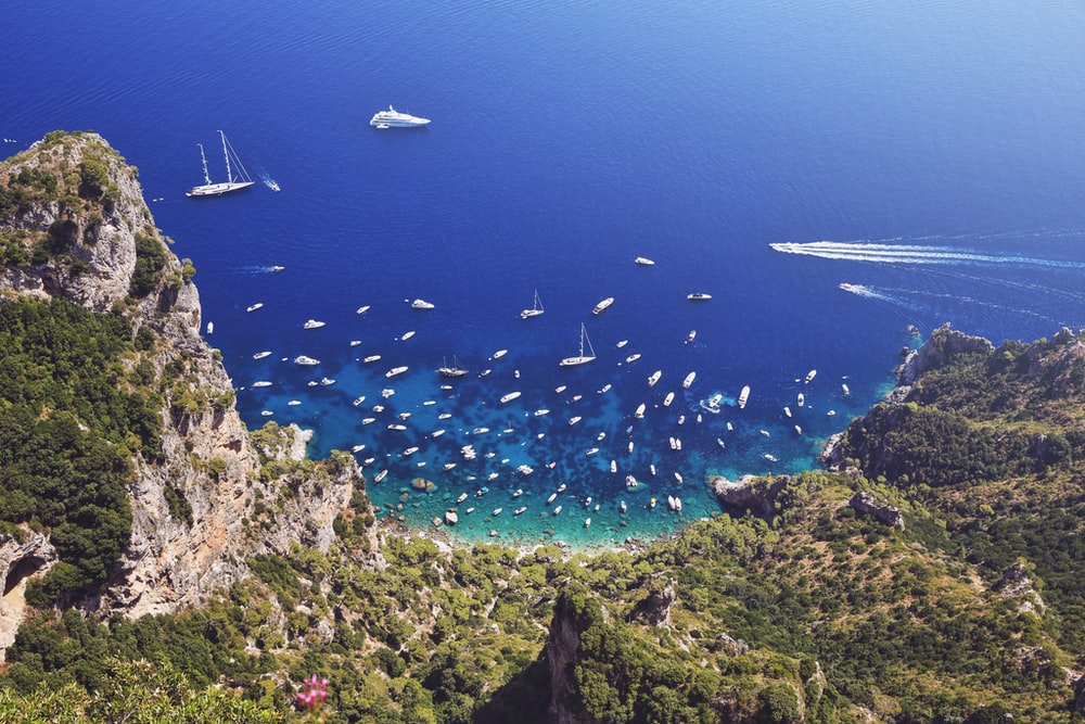 aerial view of sailboats on shore during daytime
