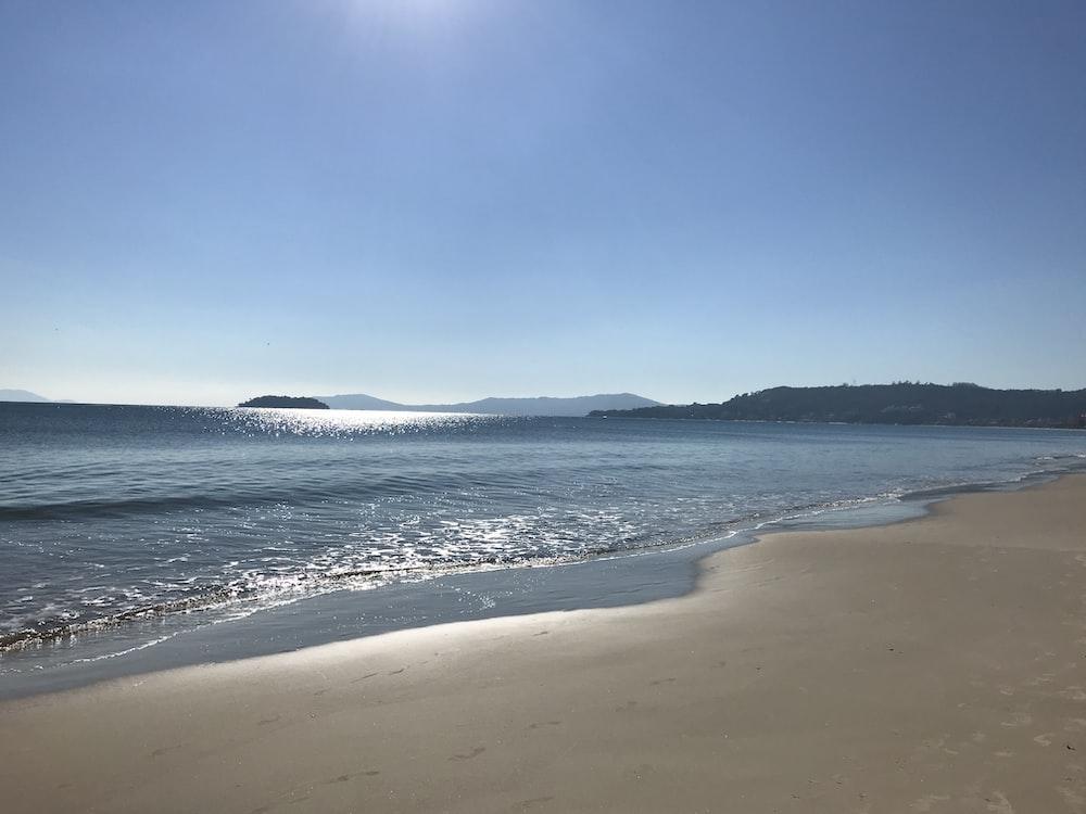 blue beach under blue sky