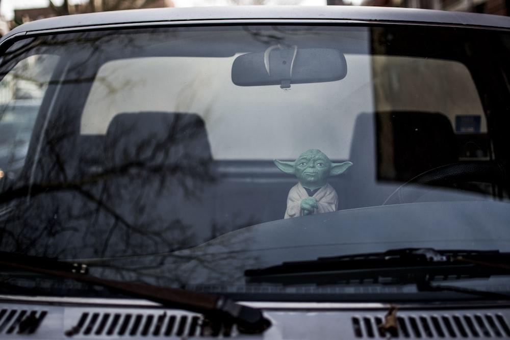 Master Yoda action figure inside vehicle