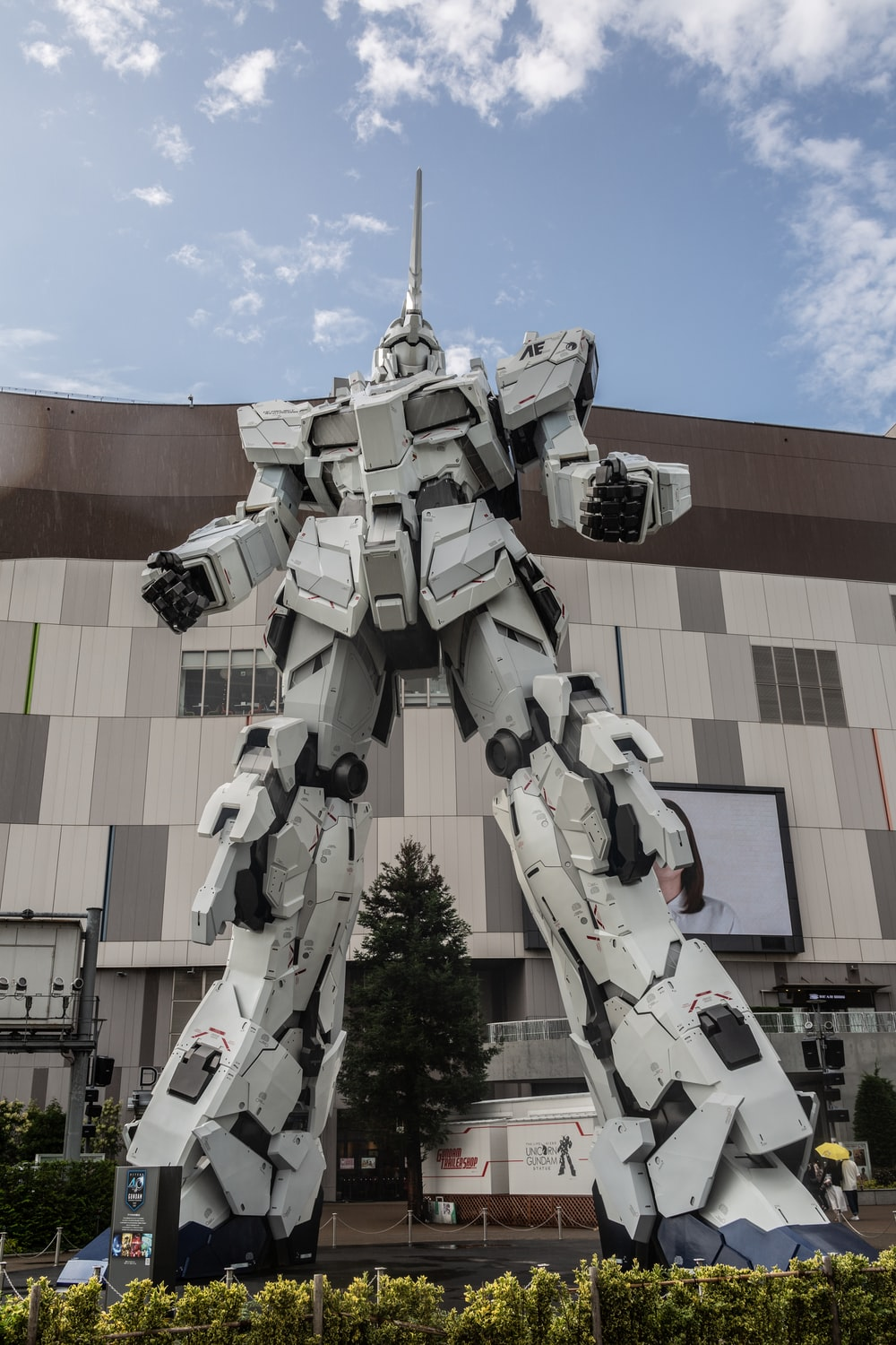 white Gundam statue in front of building