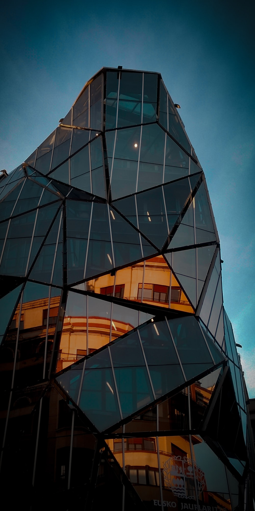 low angle photo of black curtain glass building