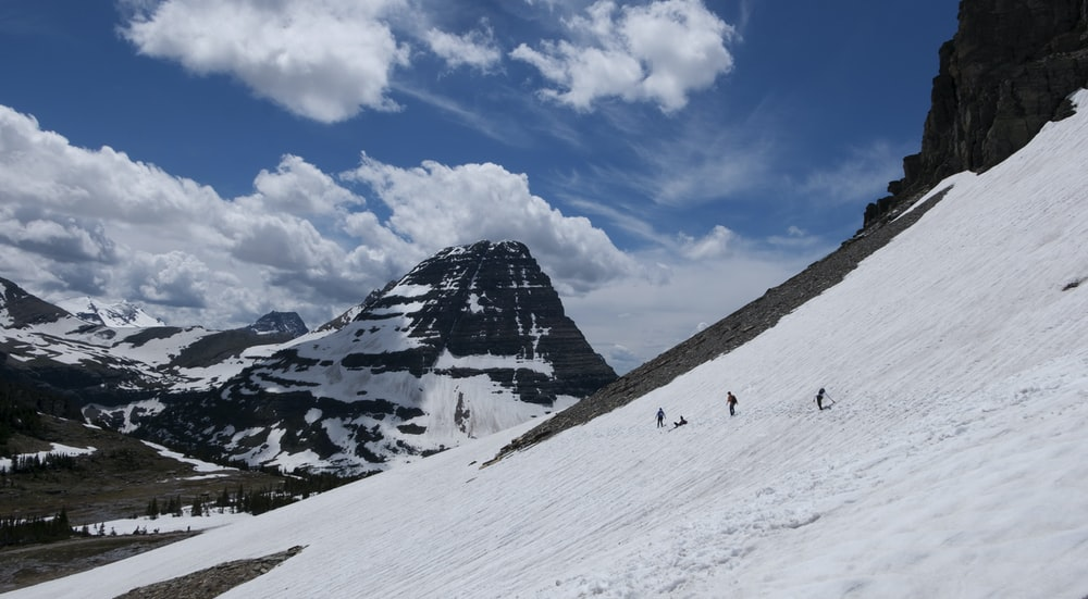 people near mountain