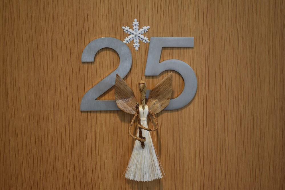angel figure on number 25 board