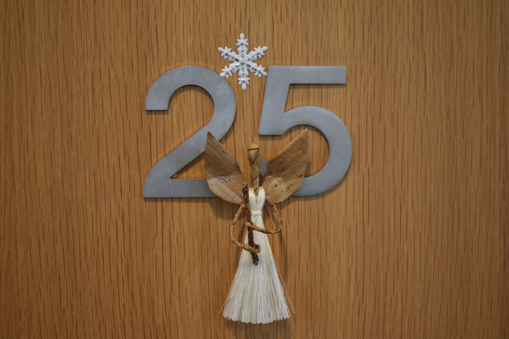 angel figure on number 25 board