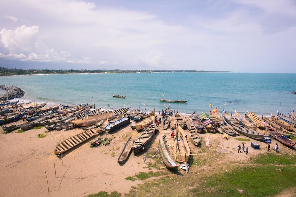 brown boat on the seashore