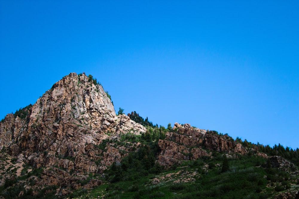 rocky cliff under blue sky