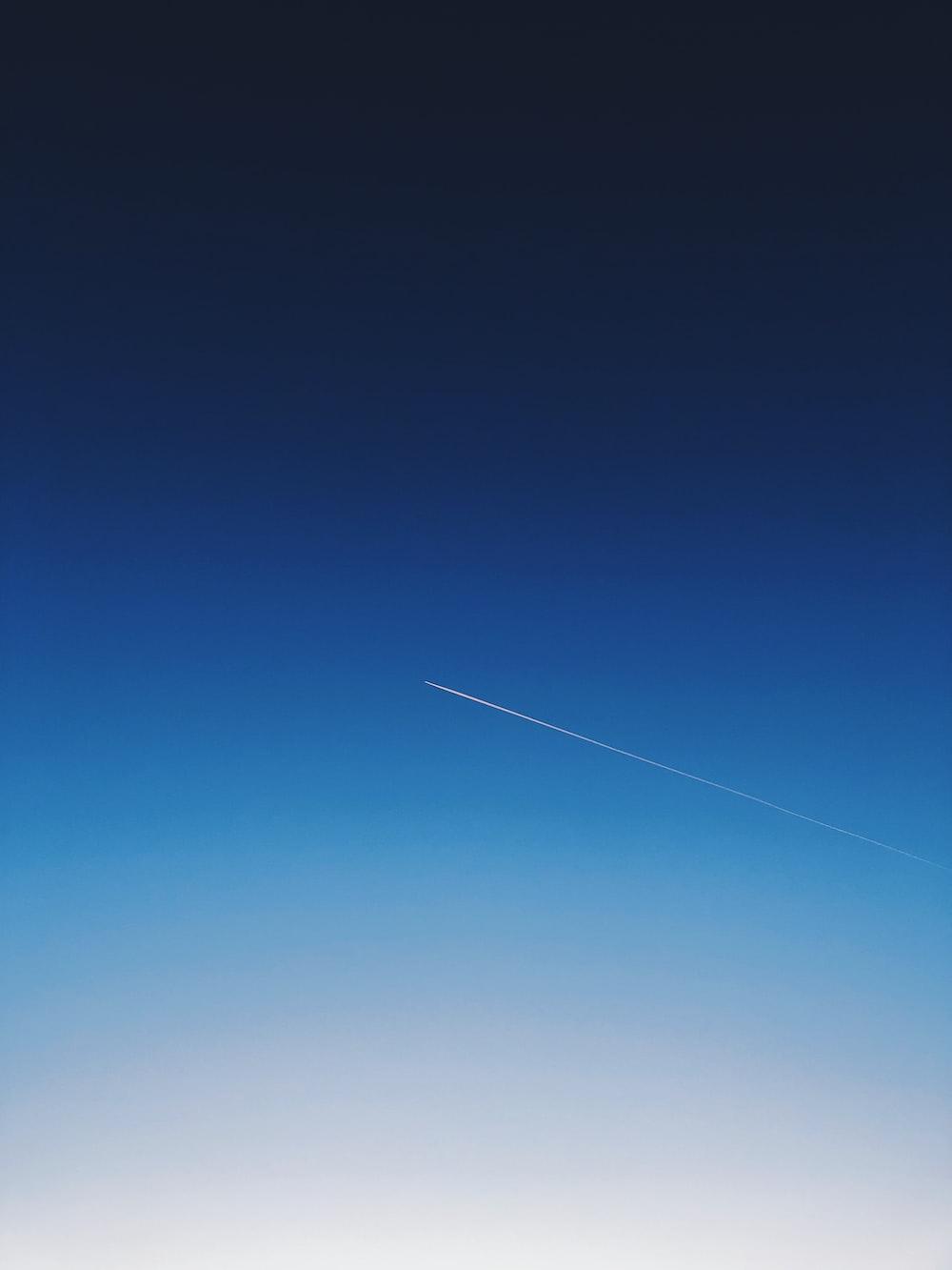 white smoke trail in the sky
