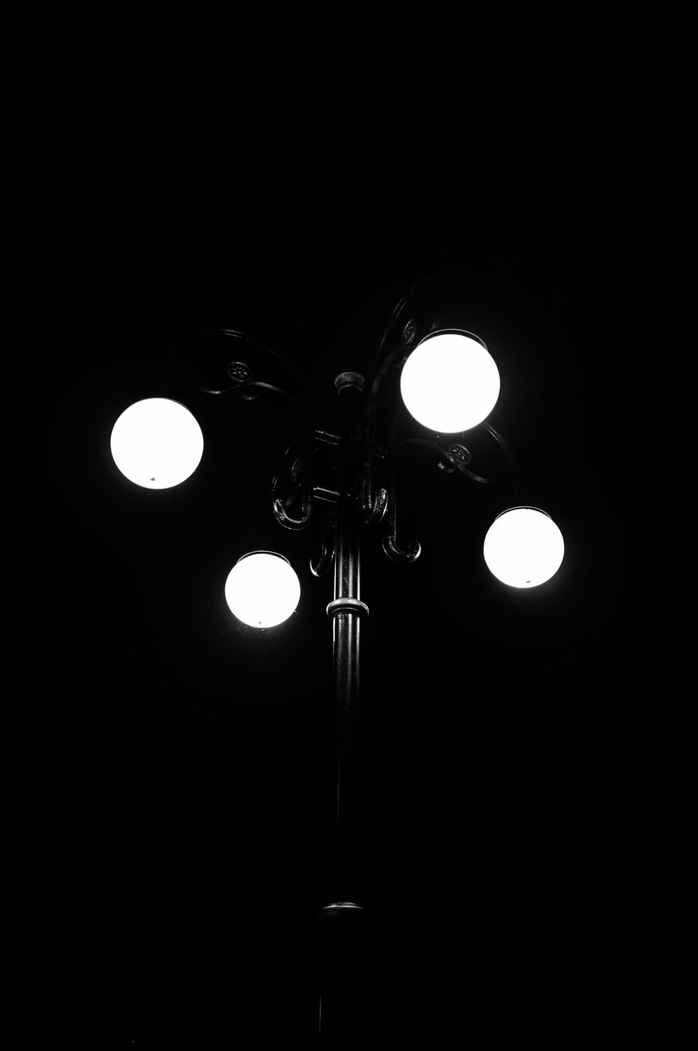 grayscale photography of lighted lamp post