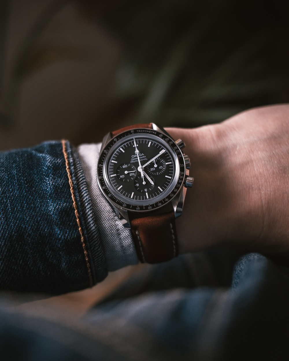 round black and silver-colored chronograph watch with brown leather band