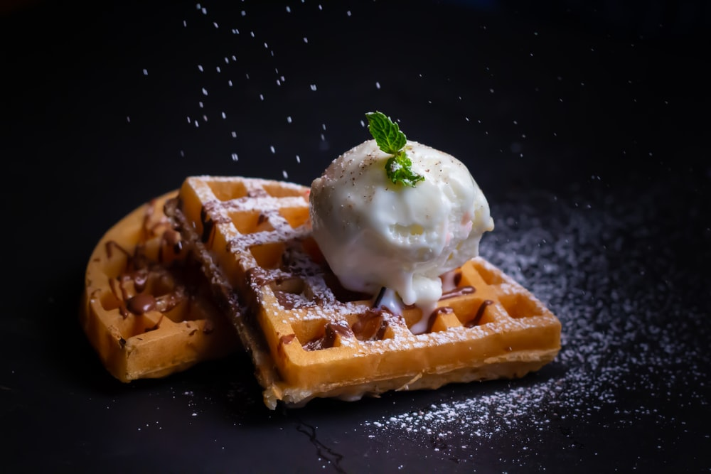 close-up photo of waffle with white ice cream