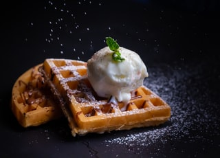 close-up photo of waffle with white ice cream