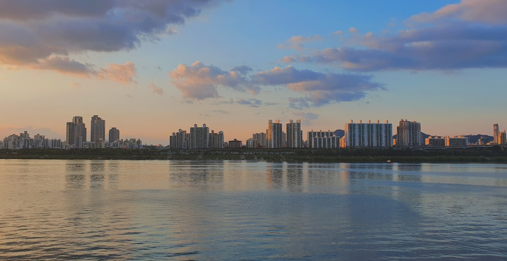 landscape photography of body of water near buildings