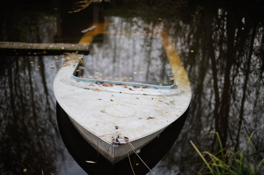 boat under water during daytime close-up photography