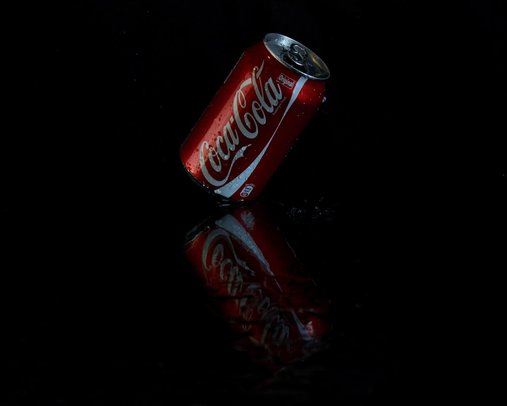 red and white Coca-cola can close-up photography