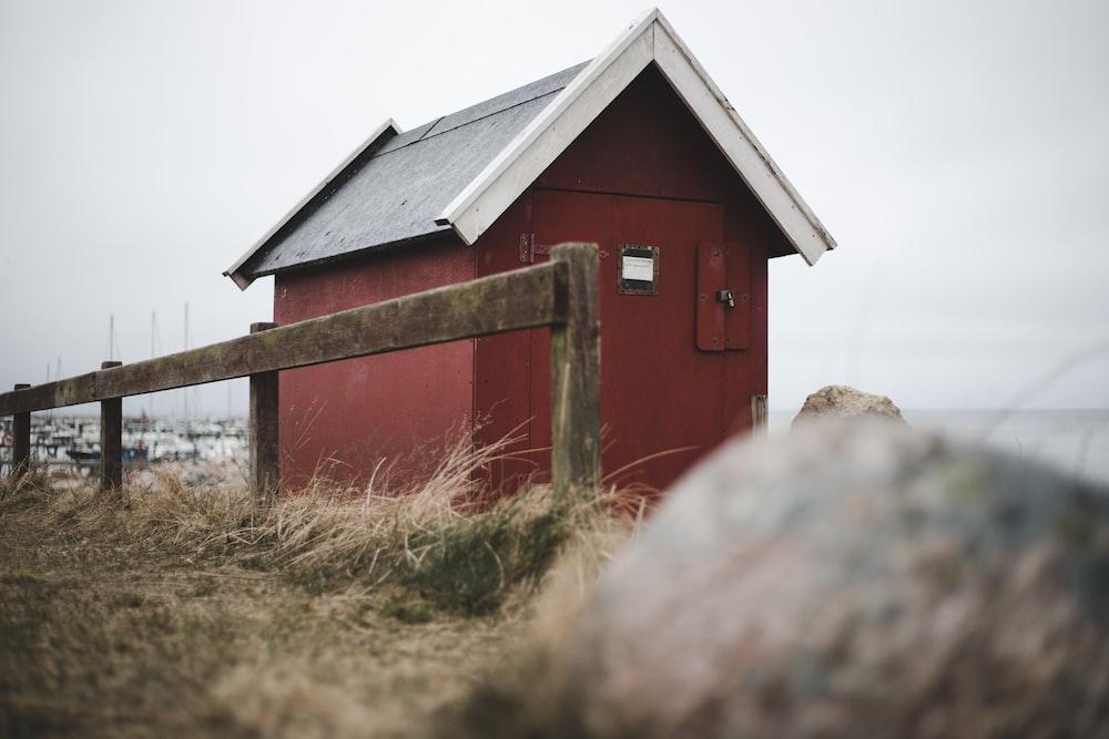 red hut during daytime
