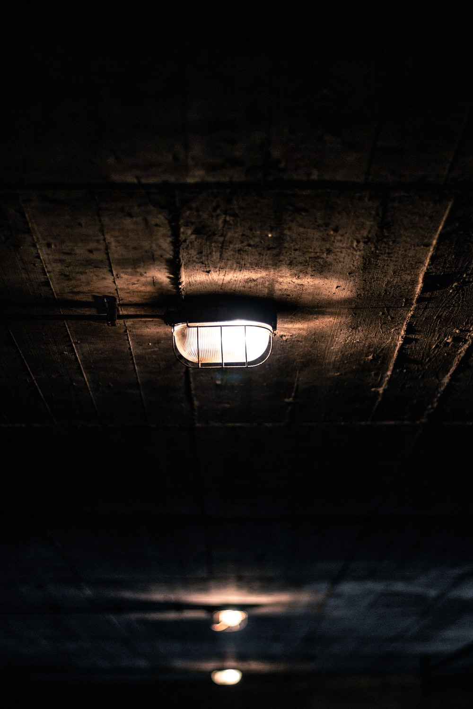 turned-on white lamp