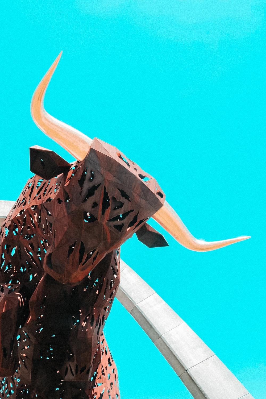 brown metal bull statue
