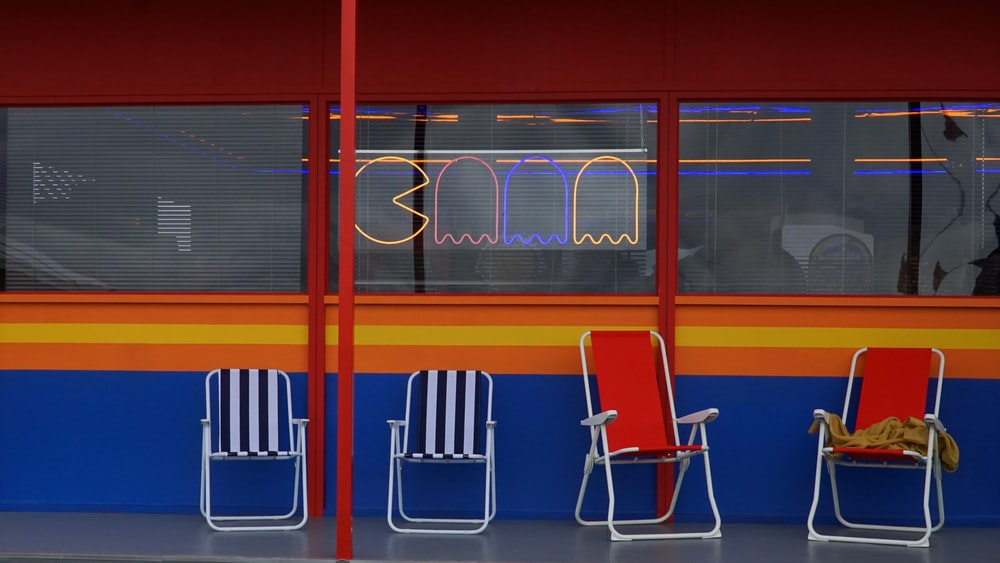 two red and two blue chairs