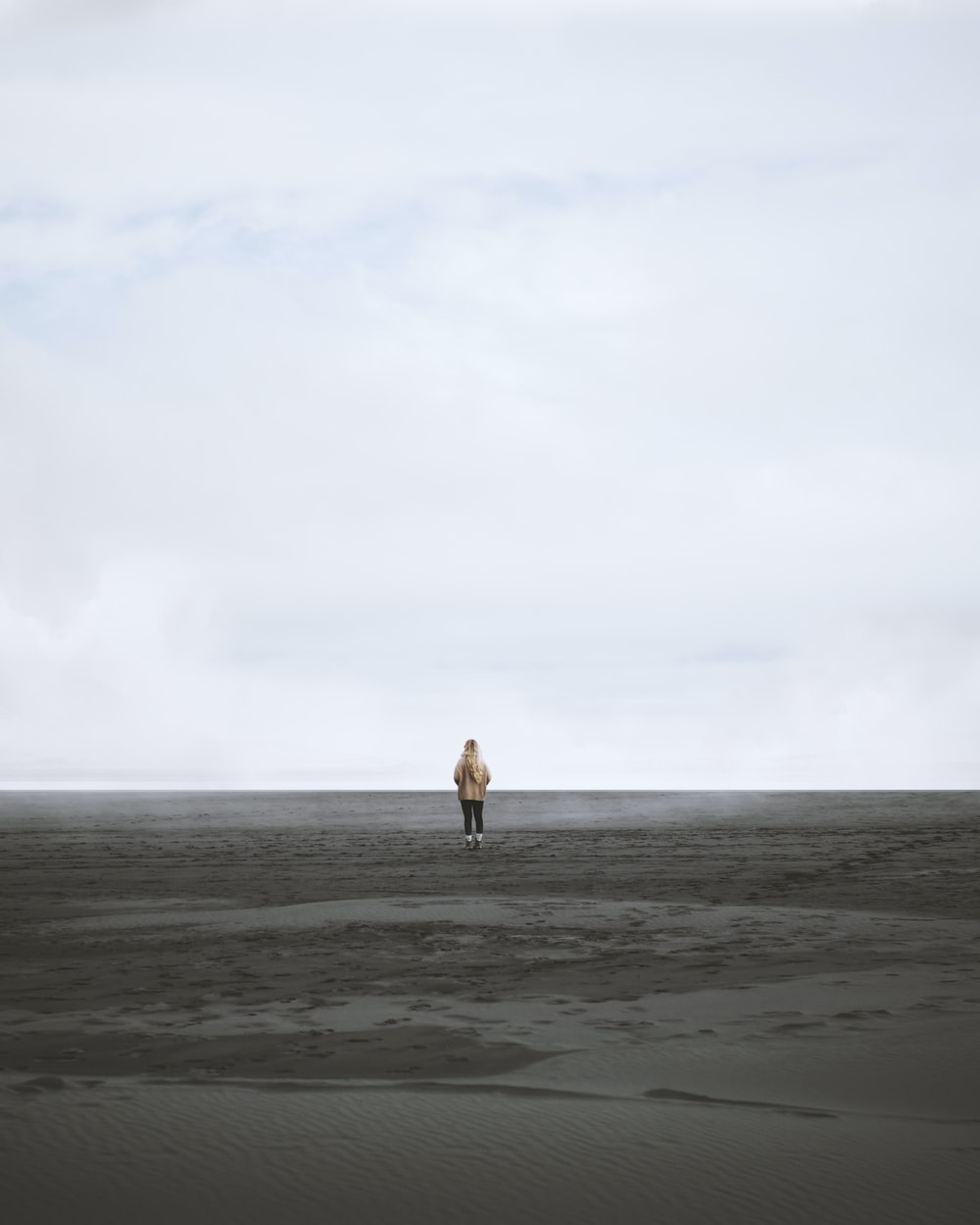 person walking on shore