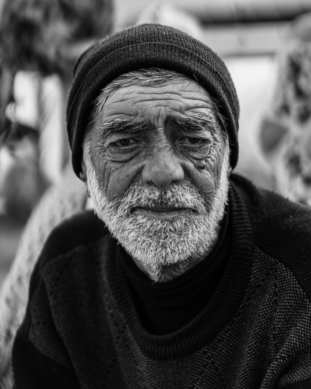 grayscale photo of man in knit cap