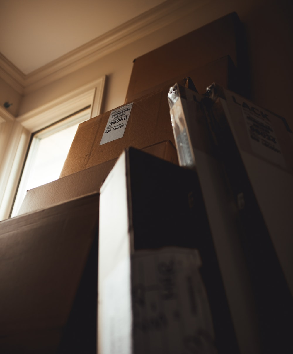 boxes leaning on cardboard box