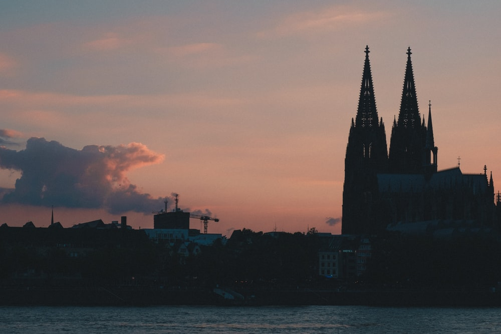 silhouette photography of church under cloudy sky during daytime