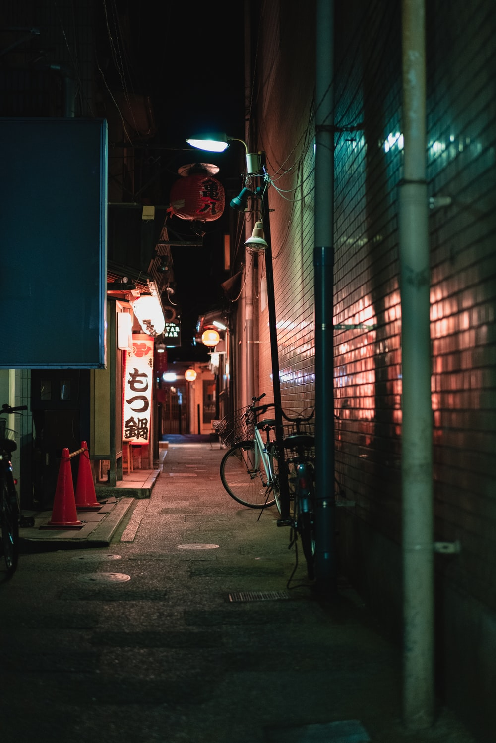 two bicycles on alley during night