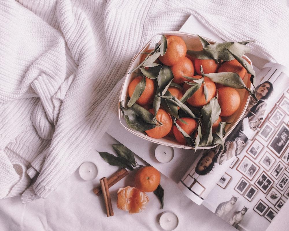 orange fruits on basket