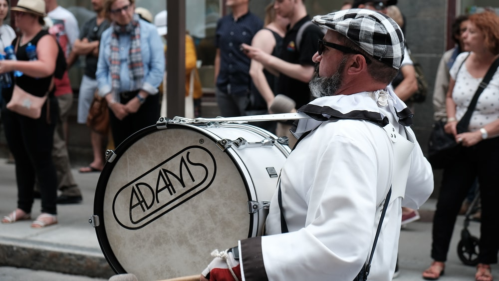 man holding drum during daytime