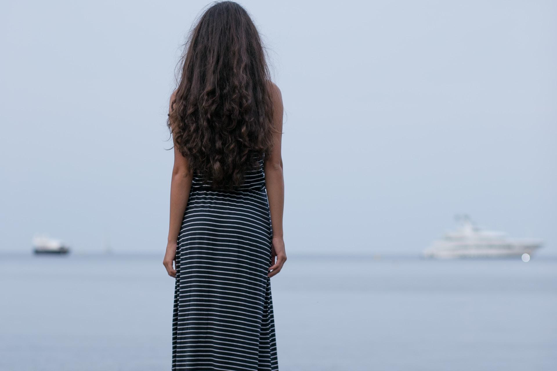 woman standing on gray pavement