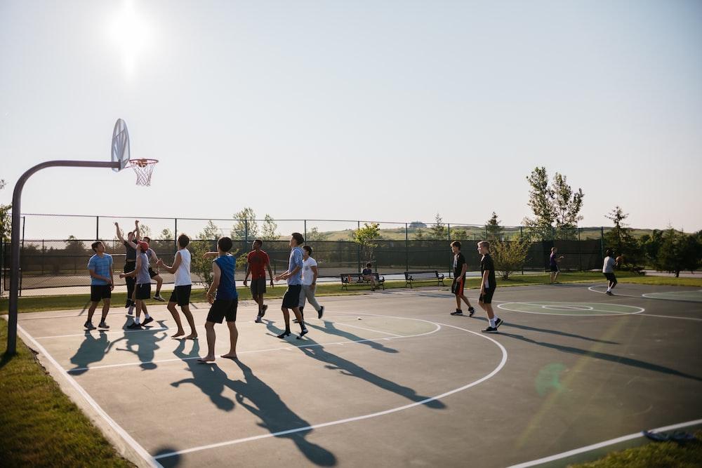 people playing basket outside at daytime