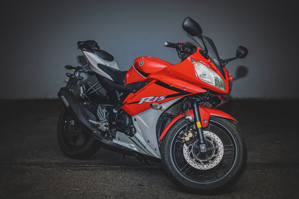 red and black Yamaha R15 sport motorcycle