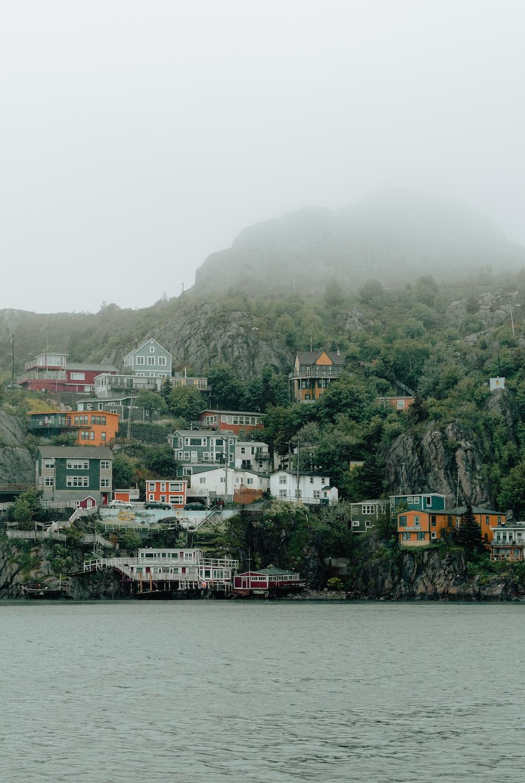 houses near mountain beside sea