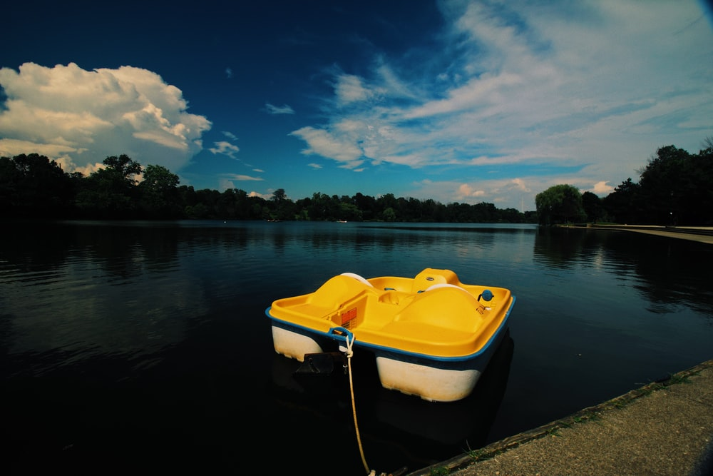 yellow and white pedal boat under clear blue sky