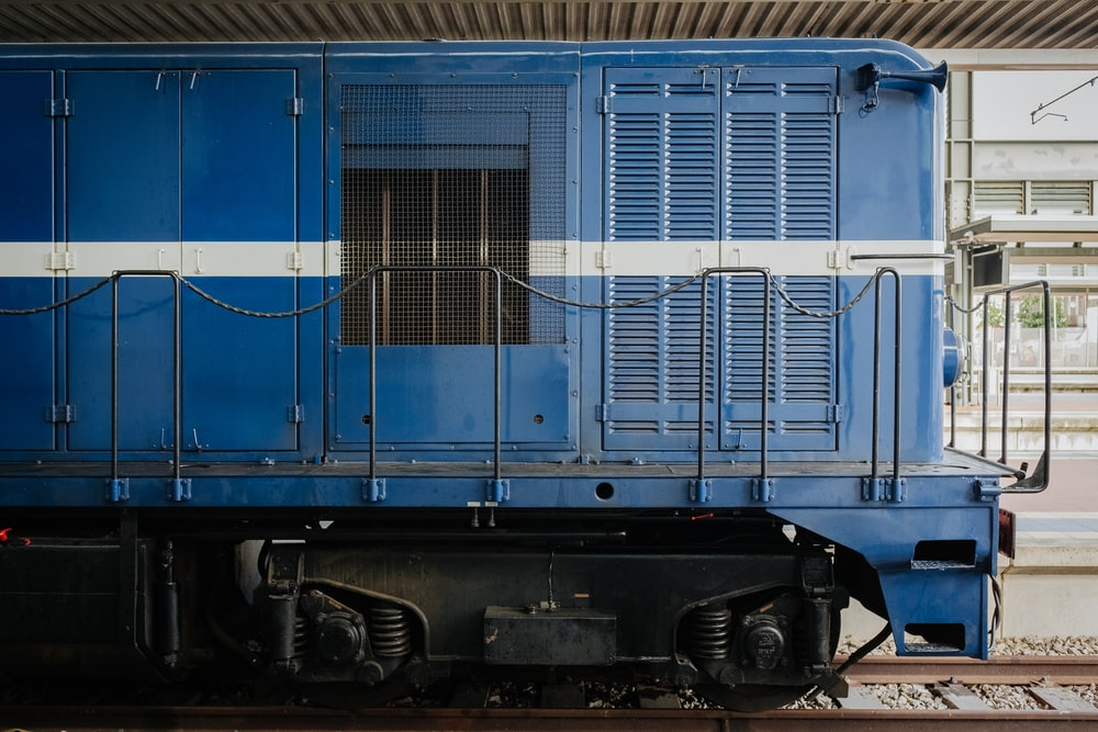 blue train on track