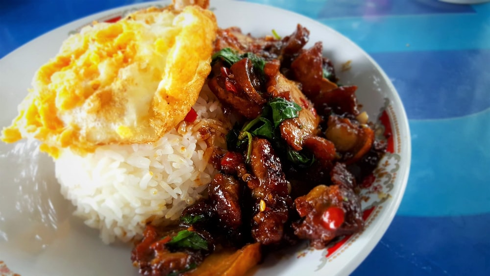 sunny-side up with rice and meat on plate