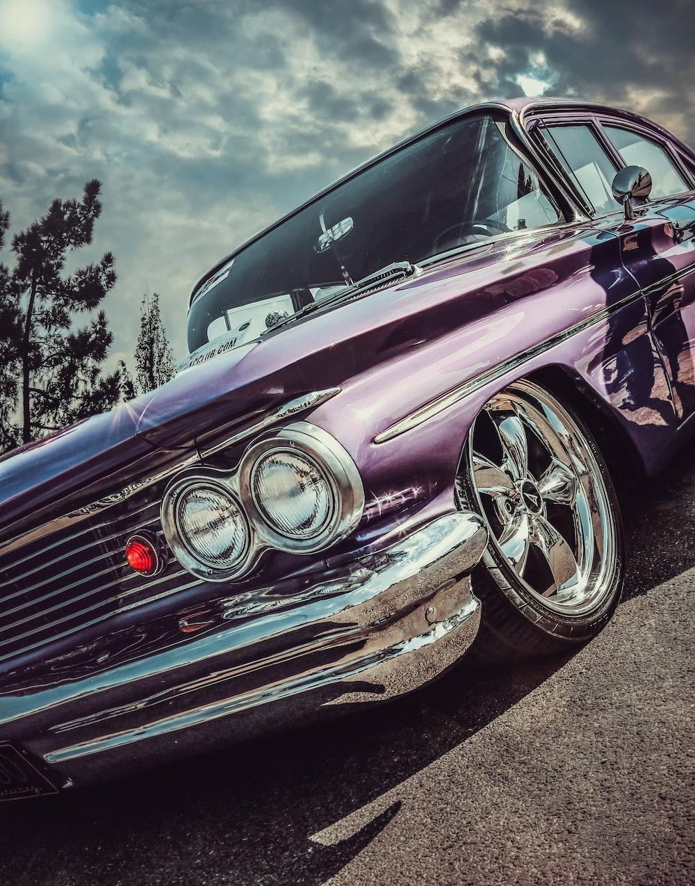 purple vehicle during daytime