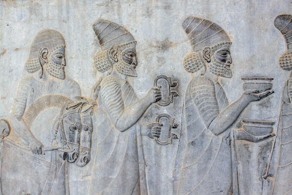 ancient embossed artwork of men