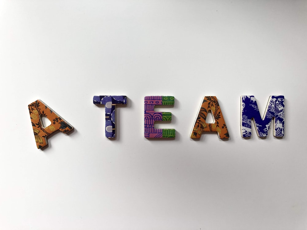 assorted-color A Team text wall decor